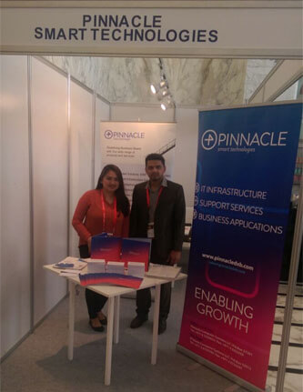 Stephanie Calamenos and Abhilash Varma welcoming visitors on Pinnacle Smart Technologies Stand
